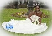Igbo bride sits on the grass with her train spread around her