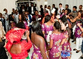 Guests on the dance floor shower the bride & groom with money at a tradditional Igbo wedding