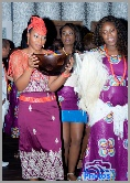The bride giving gifts to her guests during at a traditional Igbo wedding