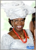 A lady in tradditional Igbo headress during a wedding